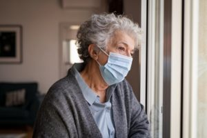 Woman wearing mask, concerned about gum disease in Dallas