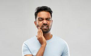 man experiencing sensitivity in dental implants in Dallas